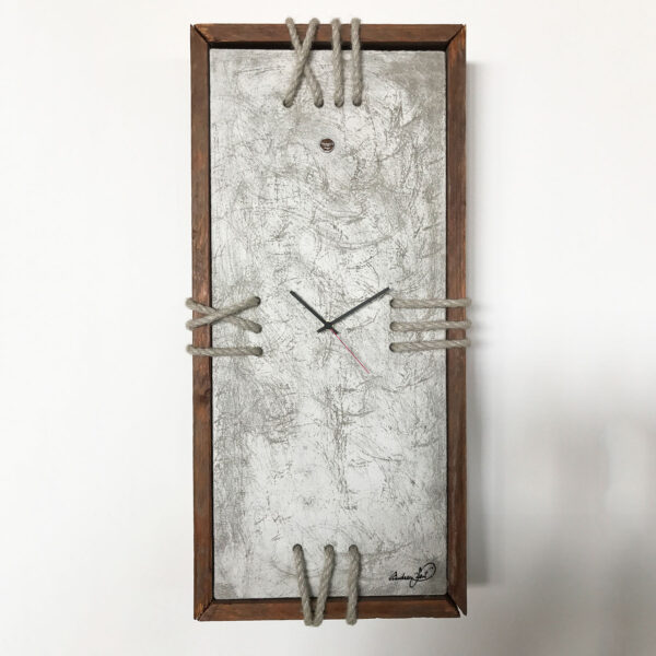 concrete wall clock with wooden edge and rope numbers